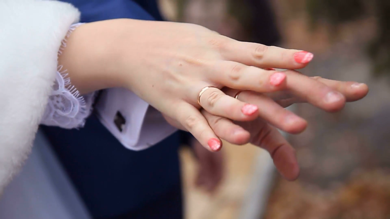 Couple holding hands on wedding love AnteAr