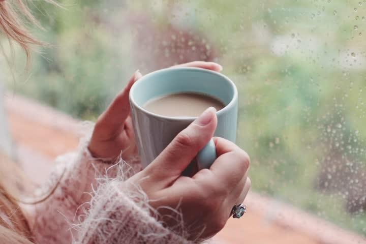 Rainy window warming coffee